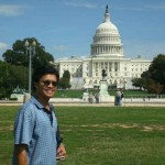Dr. Ecarma pausing in front of the U. S. Capitol Building.