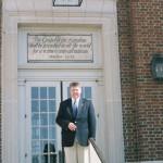 Dr. Chuck Morton in front of the Christian Broadcasting Network building in Va. Beach, VA